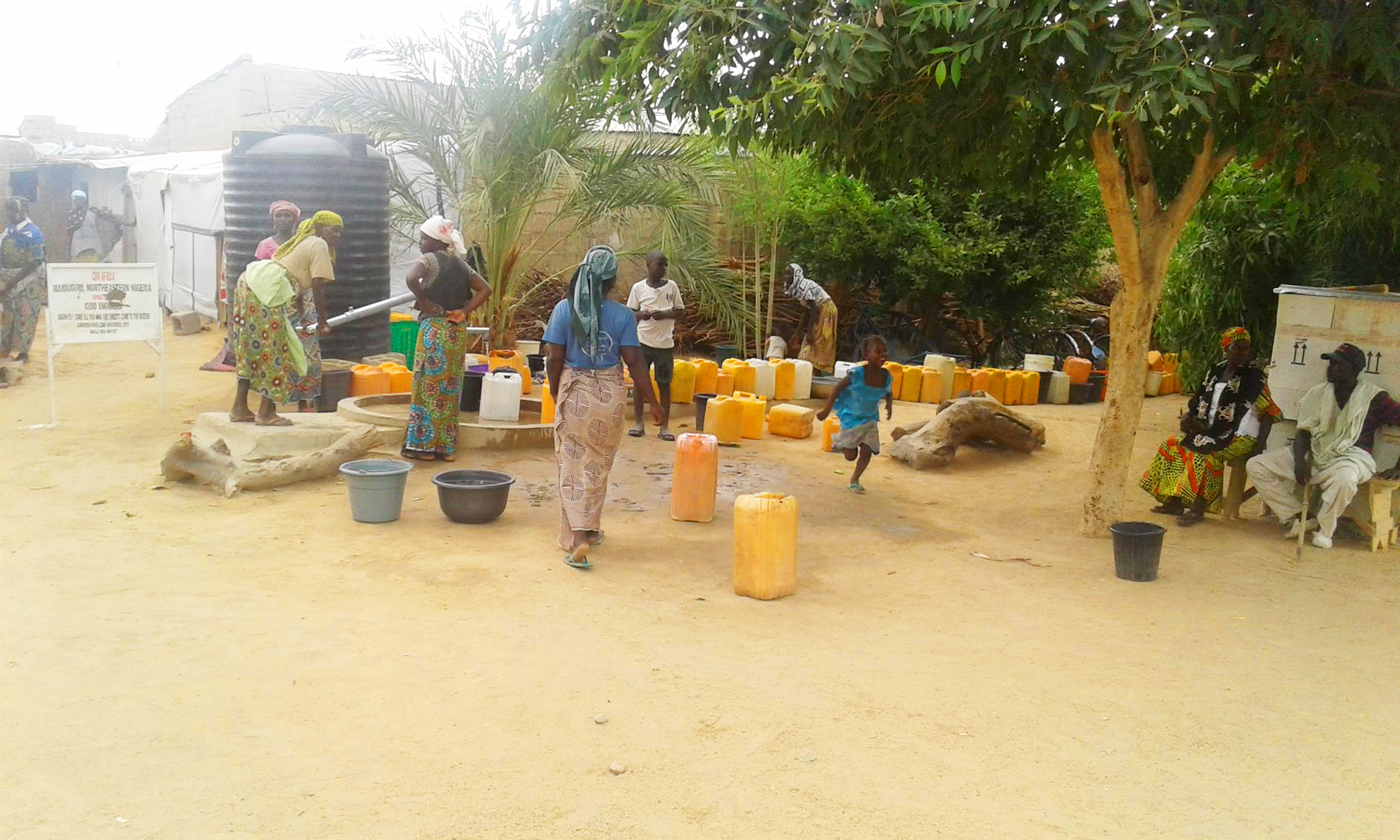 Women gathering at a water pump in Maiduguri, Nigeria ©IMPACT/2017