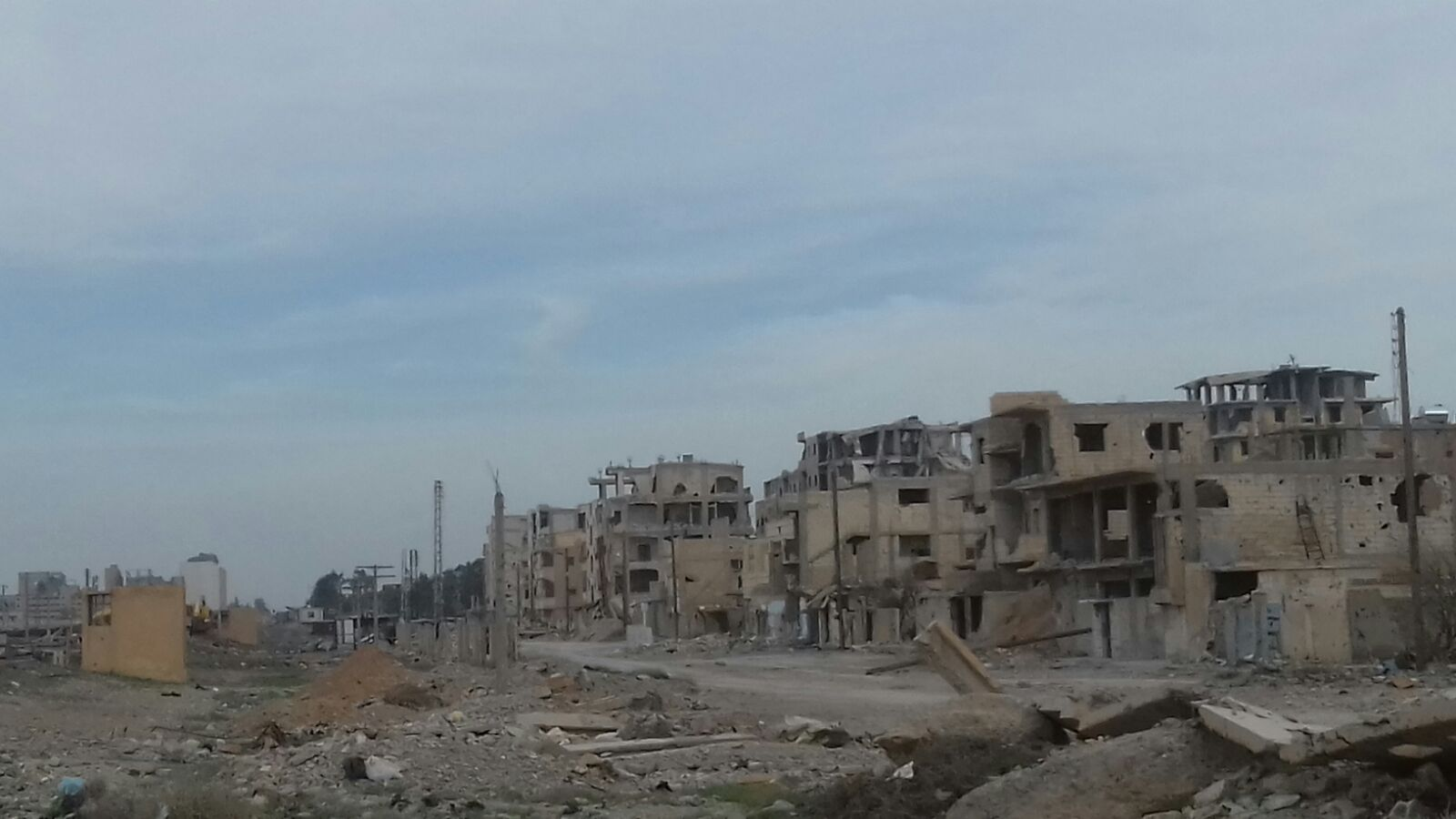 Destroyed residential buildings in Ar-Raqqa city. ©REACH/2018